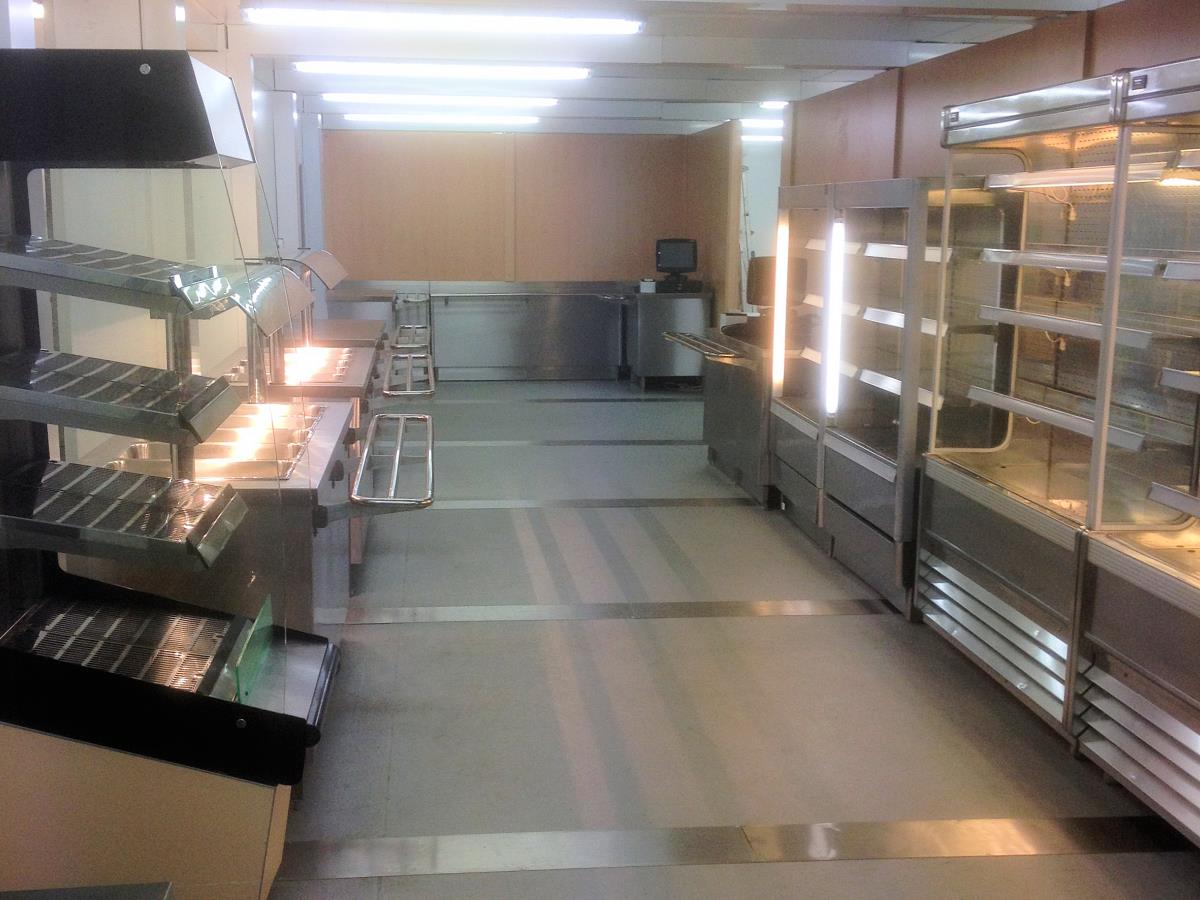 Full service area with servery equipment and refrigerated cabinets.